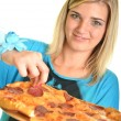 Portrait of a young woman eating a pizza over a white background — Stock Photo #13123419