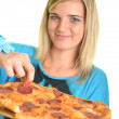 Portrait of a young woman eating a pizza over a white background — Stock Photo #13123420