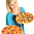 Portrait of a young woman eating a pizza over a white background — Stock Photo #13123424
