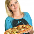 Young woman eating a piece of pizza against a white background — Stock Photo #13123428