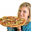 Young woman eating a piece of pizza against a white background — Stock Photo #13123433