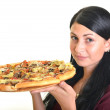 Beautiful girl eating pizza for lunch isolated on white — Stock Photo #13123438