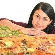 Royalty-Free Stock Photo: Young woman eating a piece of pizza against a white background