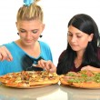 Stock Photo: Beautiful girls eating pizza for lunch