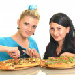 Beautiful girls eating pizza for lunch — Stock Photo #13123553