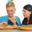 Beautiful girls eating pizza for lunch — Stock Photo #13123561
