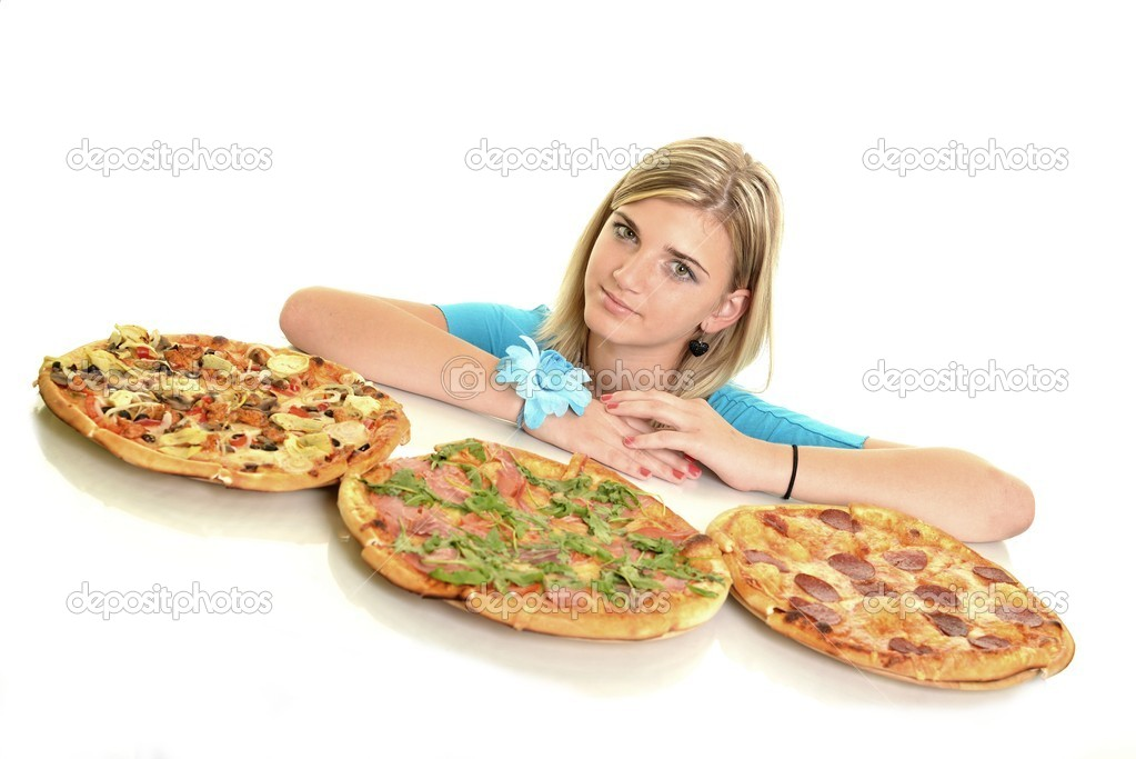 Young woman eating a piece of pizza against a white background — Stock Photo #13123483