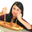 Beautiful girl eating pizza for lunch — Stock Photo #13148625