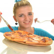 Happy girl eating pizza and looking at camera - Stock Photo