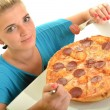 Sexy girl eating pizza - Stock Photo