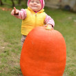 Baby with real pumpkin — Stock Photo