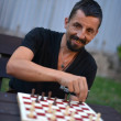 Chess player playing his game - Stock Photo