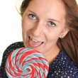 Woman with a lollipop, isolated against white — Stock Photo