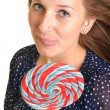 Woman with a lollipop, isolated against white — Stock Photo #13439731