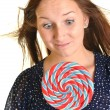 Woman with a lollipop, isolated against white — Stock Photo #13439737