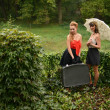 Retro women in garden — Stock Photo