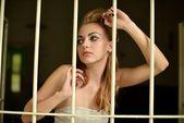 Sexy woman behind bars — Stock Photo
