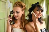 Sexy women talking on the phone. Retro portrait — Stock Photo