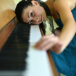 Woman playing piano - Stock Photo