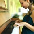 Woman playing piano — 图库照片
