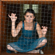 Girl behind bars - Stock Photo