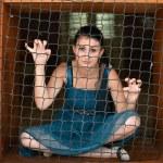 Girl behind bars — Stock Photo