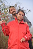 Couple picking up wild rose hip — Stock Photo
