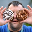 Man with donuts — Stock Photo