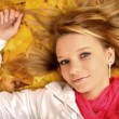 Young woman with autumn leaves — Stock Photo #14032245