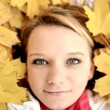 Young woman with autumn leaves — Stock fotografie