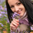 Cute young woman with flowers — Stock Photo