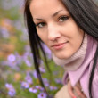 Cute young woman with flowers — Stock Photo #14320399