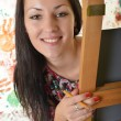 Stock Photo: Beautiful woman painting with a paintbrush