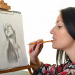 Beautiful woman painting — Stock Photo
