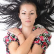 Woman with beauty long black hair - posing at studio — Stock Photo