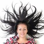 Woman with beauty long black hair - posing at studio — Stock Photo #14514445