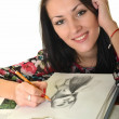 Woman painting with pencil on canvas for fun at home — Stock Photo #14515545