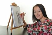 Woman painting with pencil on canvas for fun at home — Stock Photo