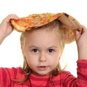 Little girl eating pizza — Stock Photo