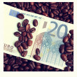 Royalty-Free Stock Photo: Background of dollar bills and coffee beans