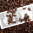 Background of dollar bills and coffee beans — Stockfoto