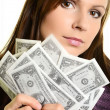 Pretty woman holding fan made of money and contemplating — Stock Photo #15315741
