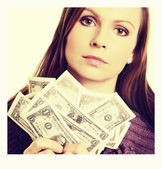 Pretty woman holding fan made of money and contemplating — Stock Photo