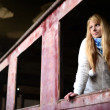 Young woman standing near a train - Stock Photo