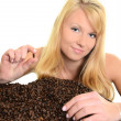 Coffee. Beautiful Girl with Coffee beans — Stock Photo