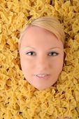 Beautiful young blonde in pasta — Stock Photo