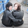 Outdoor portrait of a punk couple - Stock Photo