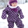 : Happy little kid is playing in snow, good winter weather — Stock Photo