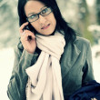 Young woman using mobile phone outdoors - Lizenzfreies Foto