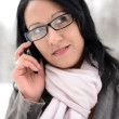 Young woman using mobile phone outdoors - Foto de Stock